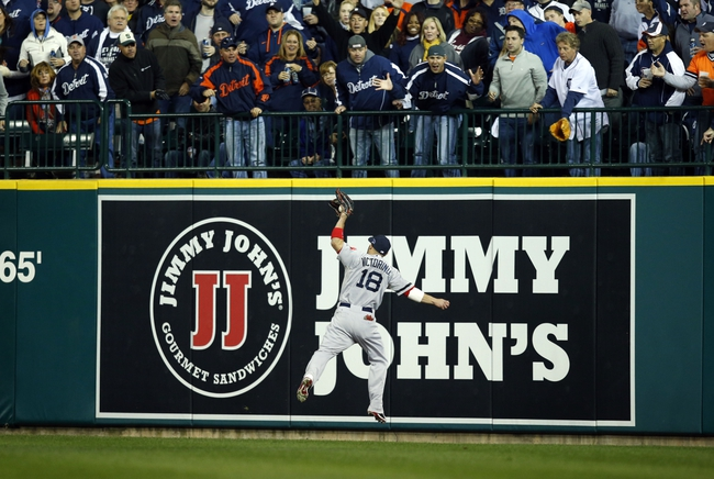 Oct 16, 2013; Detroit, MI, USA;  Boston Red Sox right fielder Shane Victorino (18) makes a catch against Detroit Tigers third baseman Miguel Cabrera (not pictured) during the seventh inning in game four of the American League Championship Series baseball game at Comerica Park. Mandatory Credit: Rick Osentoski-USA TODAY Sports