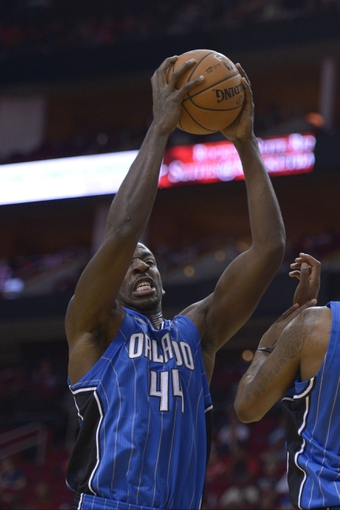 Oct 16, 2013; Houston, TX, USA; Orlando Magic power forward Andrew Nicholson (44) grabs a rebound against the Houston Rockets during the second half at Toyota Center. The Rockets won 108-104. Mandatory Credit: Thomas Campbell-USA TODAY Sports