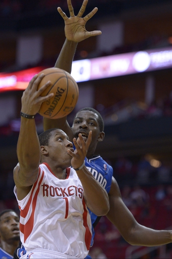 Oct 16, 2013; Houston, TX, USA; Houston Rockets point guard Isaiah Canaan (1) drives against Orlando Magic power forward Andrew Nicholson (44) during the second half at Toyota Center. The Rockets won 108-104. Mandatory Credit: Thomas Campbell-USA TODAY Sports
