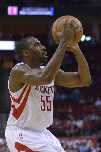 Oct 16, 2013; Houston, TX, USA; Houston Rockets shooting guard Reggie Williams (55) shoots against the Orlando Magic during the second half at Toyota Center. The Rockets won 108-104. Mandatory Credit: Thomas Campbell-USA TODAY Sports