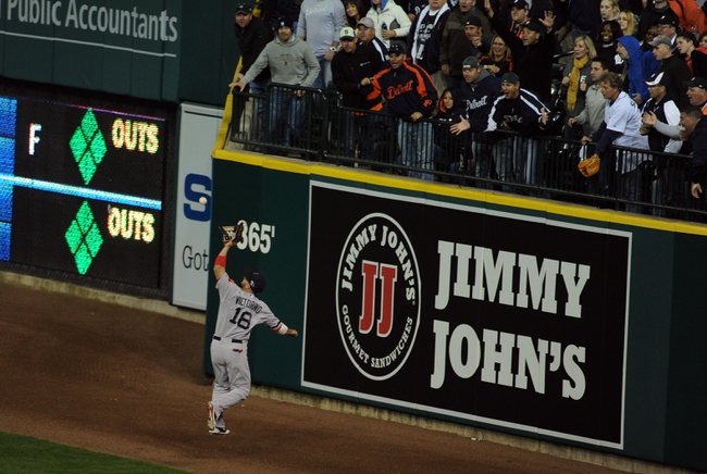 Oct 16, 2013; Detroit, MI, USA;   Boston Red Sox right fielder Shane Victorino (18) makes a catch against Detroit Tigers third baseman Miguel Cabrera (not pictured) during the seventh inning in game four of the American League Championship Series baseball game at Comerica Park.  Mandatory Credit: Tim Fuller-USA TODAY Sports