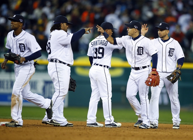 Oct 16, 2013; Detroit, MI, USA; Detroit Tigers shortstop Jose Iglesias (right) celebrates with first baseman Prince Fielder (28) after defeating the Boston Red Sox 7-3 in game four of the American League Championship Series baseball game at Comerica Park. Mandatory Credit: Rick Osentoski-USA TODAY Sports