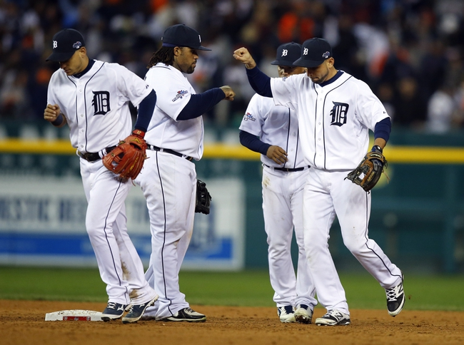 Oct 16, 2013; Detroit, MI, USA; Detroit Tigers second baseman Omar Infante (right) celebrates with first baseman Prince Fielder (28) after defeating the Boston Red Sox 7-3 in game four of the American League Championship Series baseball game at Comerica Park. Mandatory Credit: Rick Osentoski-USA TODAY Sports