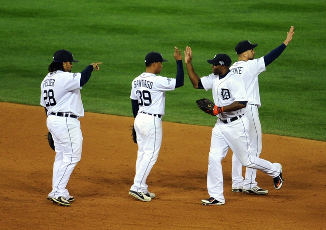 Oct 16, 2013; Detroit, MI, USA; Detroit Tigers right fielder Torii Hunter (right) celebrates with teammates after defeating the Boston Red Sox 7-3 in game four of the American League Championship Series baseball game at Comerica Park. Mandatory Credit: Tim Fuller-USA TODAY Sports
