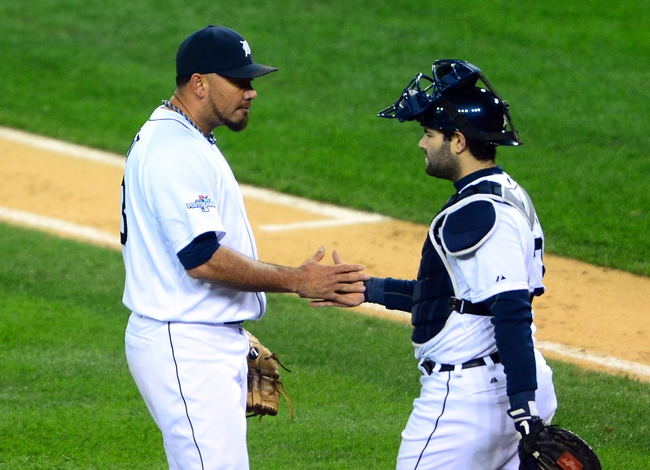 Oct 16, 2013; Detroit, MI, USA;  Detroit Tigers relief pitcher Joaquin Benoit (53) celebrates with catcher Alex Avila (13) after defeating the Boston Red Sox in game four of the American League Championship Series baseball game at Comerica Park. Detroit won 7-3. Mandatory Credit: Andrew Weber-USA TODAY Sports
