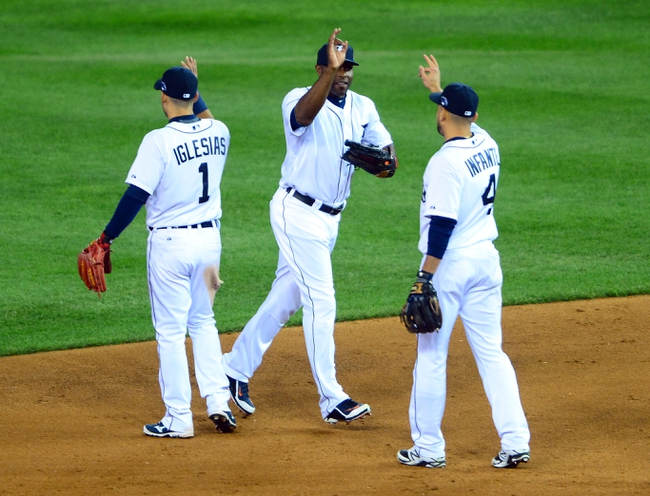 Oct 16, 2013; Detroit, MI, USA;  Detroit Tigers right fielder Torii Hunter (center) celebrates with second baseman Omar Infante (4) after defeating the Boston Red Sox in game four of the American League Championship Series baseball game at Comerica Park. Detroit won 7-3. Mandatory Credit: Andrew Weber-USA TODAY Sports