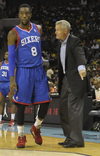 Oct 17, 2013; Charlotte, NC, USA; Philadelphia 76ers head coach Brett Brown talks to guard Tony Wroten (8) during the pre season game against the Charlotte Bobcats at Time Warner Cable Arena. Mandatory Credit: Sam Sharpe-USA TODAY Sports
