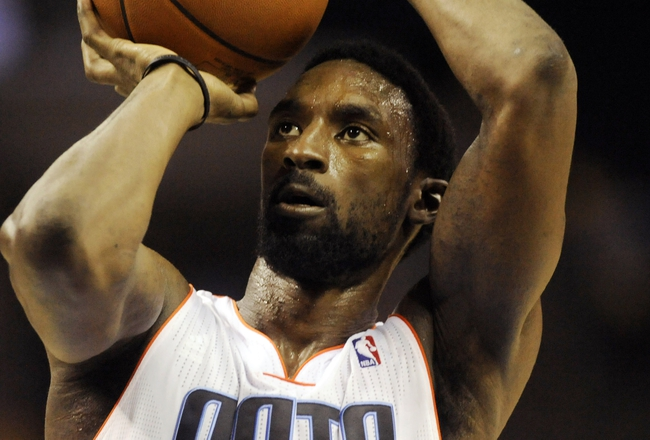 Oct 17, 2013; Charlotte, NC, USA; Charlotte Bobcats guard Ben Gordon (8) shoots a foul shot during the pre season game against the Philadelphia 76ers at Time Warner Cable Arena. Bobcats win 110-84. Mandatory Credit: Sam Sharpe-USA TODAY Sports