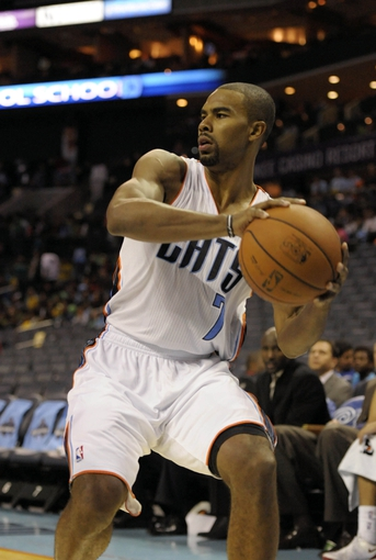 Oct 17, 2013; Charlotte, NC, USA; Charlotte Bobcats guard Ramon Sessions (7) looks to pass during the pre season game against the Philadelphia 76ers at Time Warner Cable Arena. Bobcats win 110-84. Mandatory Credit: Sam Sharpe-USA TODAY Sports