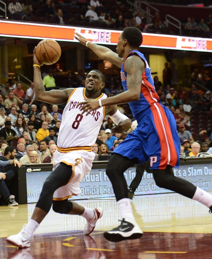Oct 17, 2013; Cleveland, OH, USA; Cleveland Cavaliers shooting guard Jermaine Taylor (8) drives to the basket as Detroit Pistons power forward Tony Mitchell (9) defends during the game at Quicken Loans Arena. Mandatory Credit: Eric P. Mull-USA TODAY Sports