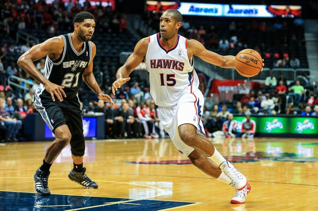 Oct 17, 2013; Atlanta, GA, USA; Atlanta Hawks power forward Al Horford (15) drives to the basket past San Antonio Spurs power forward Tim Duncan (21) in the first half at Philips Arena. Mandatory Credit: Daniel Shirey-USA TODAY Sports