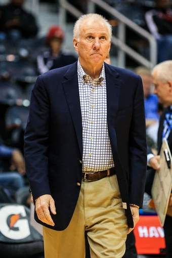 Oct 17, 2013; Atlanta, GA, USA; San Antonio Spurs head coach Gregg Popovich walks on court during a time out in the first half against the San Antonio Spurs at Philips Arena. Mandatory Credit: Daniel Shirey-USA TODAY Sports
