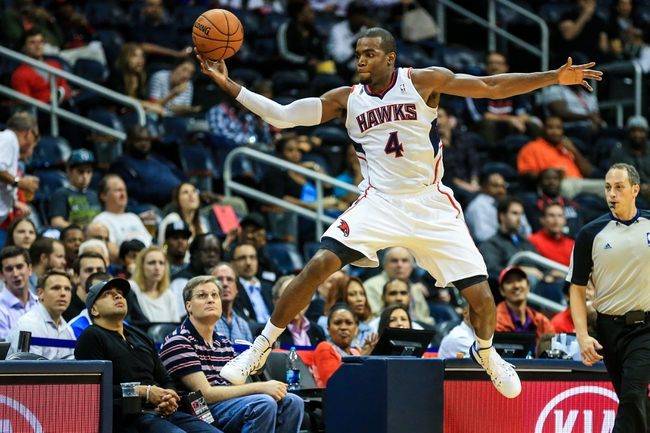 Oct 17, 2013; Atlanta, GA, USA; Atlanta Hawks power forward Paul Millsap (4) leaps to keep the ball in bounds in the first half against the San Antonio Spurs at Philips Arena. Mandatory Credit: Daniel Shirey-USA TODAY Sports