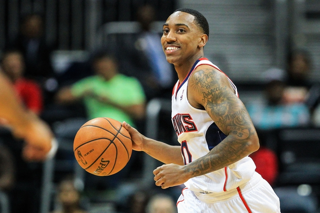 Oct 17, 2013; Atlanta, GA, USA; Atlanta Hawks point guard Jeff Teague (0) dribbles down court in the first half against the San Antonio Spurs at Philips Arena. Mandatory Credit: Daniel Shirey-USA TODAY Sports