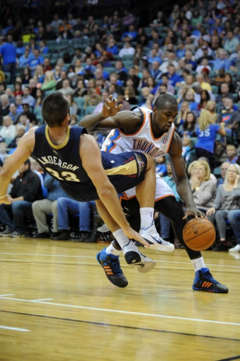 Oct 17, 2013; Tulsa, OK, USA; Oklahoma City Thunder power forward Serge Ibaka (9) drives the ball against New Orleans Pelicans power forward Ryan Anderson (33) during the second quarter at BOK Center. Mandatory Credit: Mark D. Smith-USA TODAY Sports