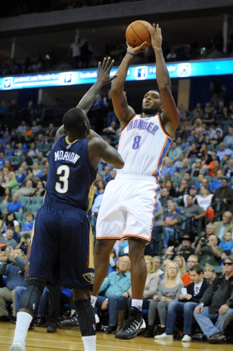 Oct 17, 2013; Tulsa, OK, USA; Oklahoma City Thunder small forward Ryan Gomes (8) attempts a shot against New Orleans Pelicans shooting guard Anthony Morrow (3) during the second quarter at BOK Center. Mandatory Credit: Mark D. Smith-USA TODAY Sports
