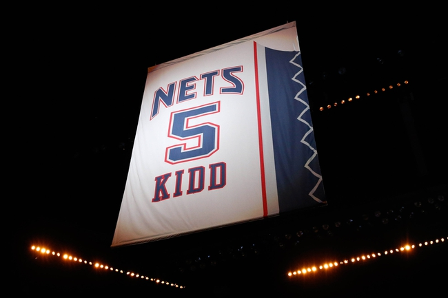 Oct 17, 2013; Brooklyn, NY, USA;  Brooklyn Nets head coach Jason Kidd's jersey number rises in retirement at Barclays Center before the game against the Miami Heat. Mandatory Credit: Anthony Gruppuso-USA TODAY Sports