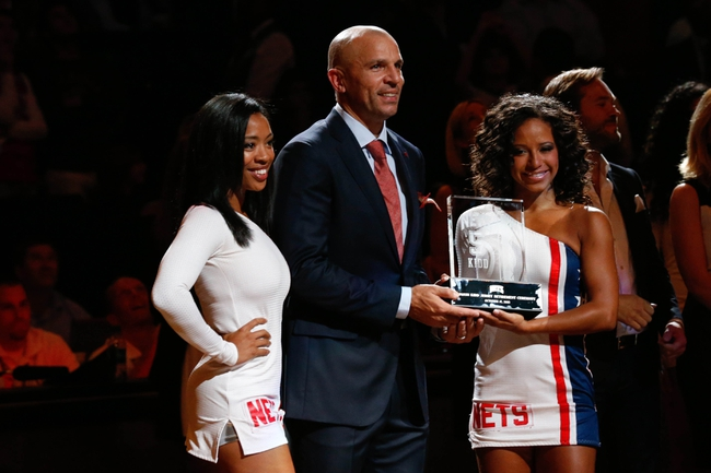 Oct 17, 2013; Brooklyn, NY, USA;  Brooklyn Nets head coach Jason Kidd receives a crystal jersey during his jersey number retirement ceremony before the game against the Miami Heat at Barclays Center. Mandatory Credit: Anthony Gruppuso-USA TODAY Sports