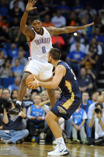 Oct 17, 2013; Tulsa, OK, USA; Oklahoma City Thunder small forward Ryan Gomes (8) attempts to block a shot by New Orleans Pelicans power forward Ryan Anderson (33) during the first quarter at BOK Center. Mandatory Credit: Mark D. Smith-USA TODAY Sports