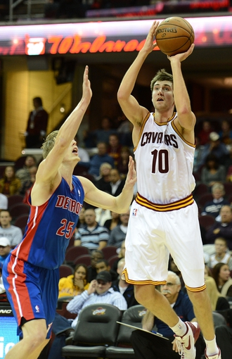 Oct 17, 2013; Cleveland, OH, USA; Cleveland Cavaliers shooting guard Sergey Karasev (10) shoots as Detroit Pistons shooting guard Kyle Singler (25) defends during the game at Quicken Loans Arena. Mandatory Credit: Eric P. Mull-USA TODAY Sports