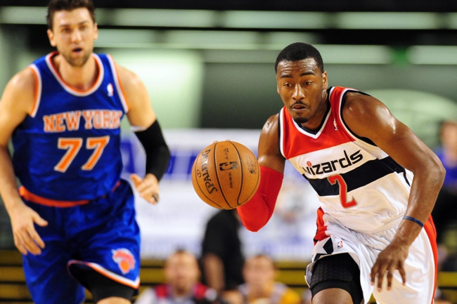 Oct 17, 2013; Baltimore, MD, USA; Washington Wizards guard John Wall (2) dribbles up court in front of New York Knicks forward Andrea Bargnani (77) at Baltimore Arena. Mandatory Credit: Evan Habeeb-USA TODAY Sports