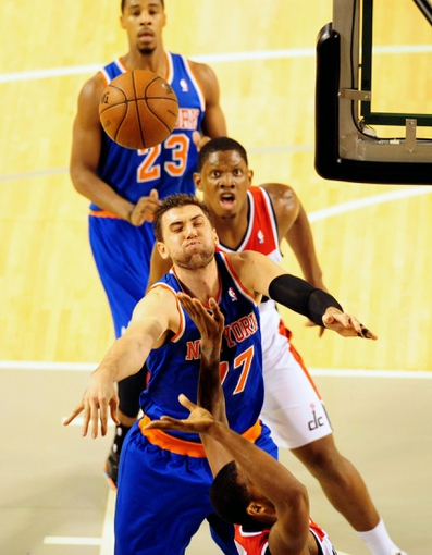 Oct 17, 2013; Baltimore, MD, USA; New York Knicks forward Andrea Bargnani (77) blocks a shot in front of Washington Wizards forward Kevin Seraphin (13) at Baltimore Arena. Mandatory Credit: Evan Habeeb-USA TODAY Sports