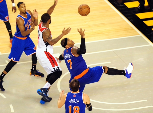 Oct 17, 2013; Baltimore, MD, USA; New York Knicks forward Carmelo Anthony (7) gets a rebound in the third quarter against the Washington Wizards at Baltimore Arena. Mandatory Credit: Evan Habeeb-USA TODAY Sports