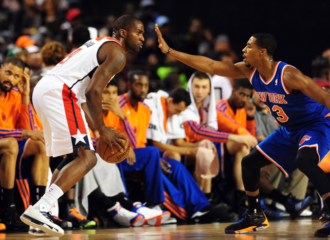 Oct 17, 2013; Baltimore, MD, USA; Washington Wizards forward Martell Webster (9) is guarded by New York Knicks guard Toure Murry (23) at Baltimore Arena. Mandatory Credit: Evan Habeeb-USA TODAY Sports