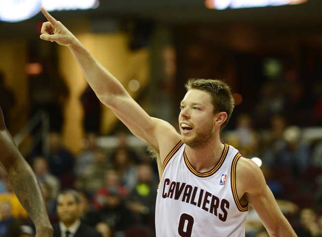 Oct 17, 2013; Cleveland, OH, USA; Cleveland Cavaliers shooting guard Matthew Dellavedova (9) points to the ball direction during the game against the Detroit Pistons at Quicken Loans Arena. Mandatory Credit: Eric P. Mull-USA TODAY Sports