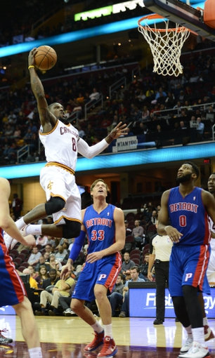 Oct 17, 2013; Cleveland, OH, USA; Cleveland Cavaliers shooting guard Jermaine Taylor (8) prepares to dunk as Detroit Pistons power forward Jonas Jerebko (33) and center Andre Drummond (0) watch during the game at Quicken Loans Arena. Mandatory Credit: Eric P. Mull-USA TODAY Sports
