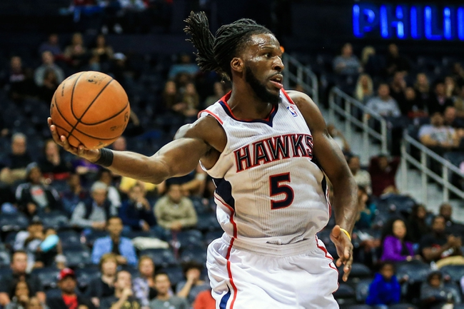 Oct 17, 2013; Atlanta, GA, USA; Atlanta Hawks small forward DeMarre Carroll (5) keeps a ball in bounds in the second half against the San Antonio Spurs at Philips Arena. The Spurs won 106-104. Mandatory Credit: Daniel Shirey-USA TODAY Sports