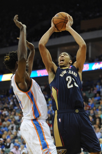 Oct 17, 2013; Tulsa, OK, USA; New Orleans Pelicans power forward Anthony Davis (23) attempts a shot against Oklahoma City Thunder center Hasheem Thabeet (34) during the third quarter at BOK Center. Mandatory Credit: Mark D. Smith-USA TODAY Sports