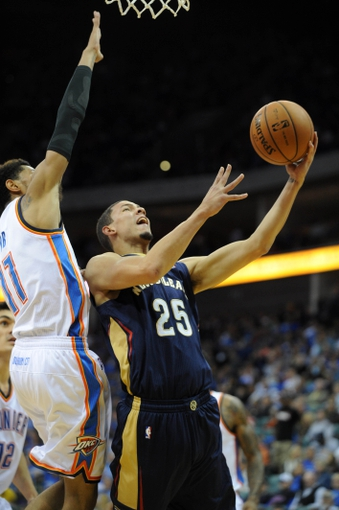 Oct 17, 2013; Tulsa, OK, USA; New Orleans Pelicans shooting guard Austin Rivers (25) attempts a shot against Oklahoma City Thunder shooting guard Jeremy Lamb (11) during the fourth quarter at BOK Center. Mandatory Credit: Mark D. Smith-USA TODAY Sports