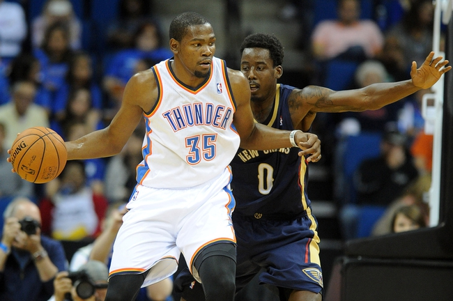 Oct 17, 2013; Tulsa, OK, USA; Oklahoma City Thunder small forward Kevin Durant (35) handles the ball against New Orleans Pelicans small forward Al-Farouq Aminu (0) during the third quarter at BOK Center. Mandatory Credit: Mark D. Smith-USA TODAY Sports
