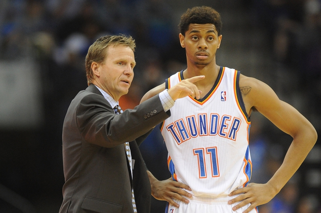 Oct 17, 2013; Tulsa, OK, USA; Oklahoma City Thunder head coach Scott Brooks talks to shooting guard Jeremy Lamb (11) in a break in action against the New Orleans Pelicans at BOK Center. Mandatory Credit: Mark D. Smith-USA TODAY Sports