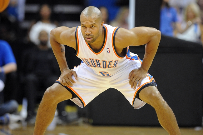 Oct 17, 2013; Tulsa, OK, USA; Oklahoma City Thunder point guard Derek Fisher (6) sets up for defense against the New Orleans Pelicans during the second quarter at BOK Center. Mandatory Credit: Mark D. Smith-USA TODAY Sports