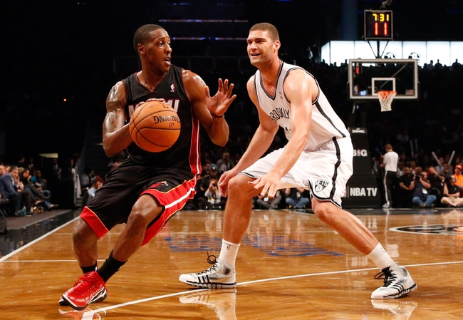 Oct 17, 2013; Brooklyn, NY, USA;  Miami Heat point guard Mario Chalmers (15) steals the ball from Brooklyn Nets center Brook Lopez (11) during the third quarter at Barclays Center. Brooklyn won 86-62.  Mandatory Credit: Anthony Gruppuso-USA TODAY Sports