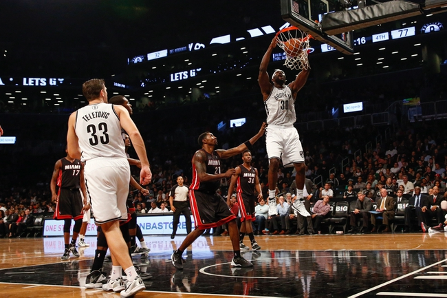 Oct 17, 2013; Brooklyn, NY, USA;  Brooklyn Nets power forward Reggie Evans (30) dunks during the fourth quarter Miami Heat at Barclays Center. Brooklyn won 86-62.  Mandatory Credit: Anthony Gruppuso-USA TODAY Sports
