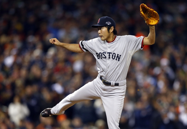 Oct 17, 2013; Detroit, MI, USA; Boston Red Sox relief pitcher Koji Uehara (19) throws against the Detroit Tigers during the eighth inning in game five of the American League Championship Series baseball game at Comerica Park. Mandatory Credit: Rick Osentoski-USA TODAY Sports