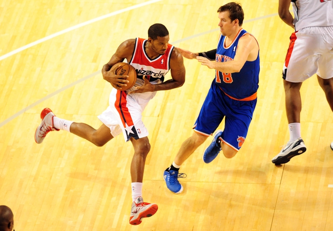 Oct 17, 2013; Baltimore, MD, USA; Washington Wizards forward Trevor Ariza (1) drives to the basket against New York Knicks guard Beno Udrih (18) at Baltimore Arena. Mandatory Credit: Evan Habeeb-USA TODAY Sports
