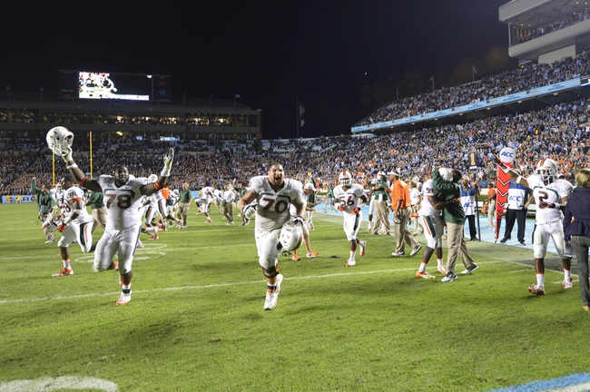 Oct 17, 2013; Chapel Hill, NC, USA; Miami Hurricanes defensive lineman Justin Renfrow (78) and offensive linesman Jon Feliciano (70) celebrate after the game. The Miami Hurricanes defeated the North Carolina Tar Heels 27-23 at Kenan Memorial Stadium. Mandatory Credit: Bob Donnan-USA TODAY Sports