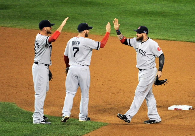 Oct 17, 2013; Detroit, MI, USA; Boston Red Sox left fielder Jonny Gomes (right) high fives shortstop Stephen Drew (7) after defeating the Detroit Tigers in game five of the American League Championship Series baseball game at Comerica Park. Boston won 4-3. Mandatory Credit: Tim Fuller-USA TODAY Sports