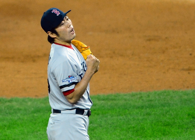 Oct 17, 2013; Detroit, MI, USA; Boston Red Sox relief pitcher Koji Uehara (19) reacts after defeating the Detroit Tigers in game five of the American League Championship Series baseball game at Comerica Park. Boston won 4-3. Mandatory Credit: Andrew Weber-USA TODAY Sports