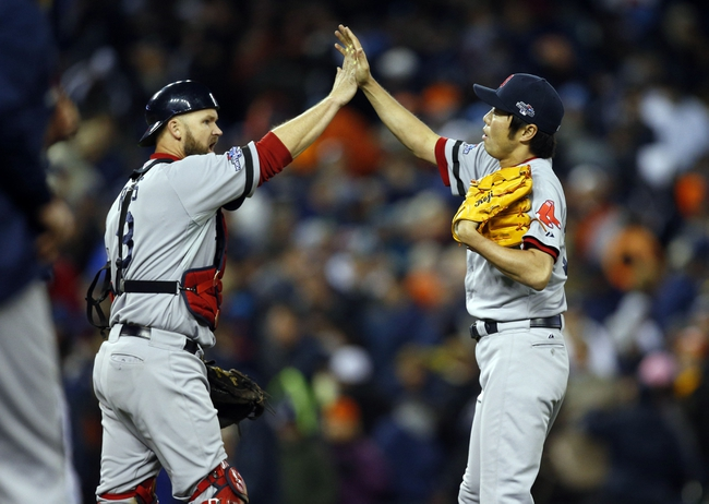 Oct 17, 2013; Detroit, MI, USA; Boston Red Sox relief pitcher Koji Uehara (19) celebrates with relief pitcher Koji Uehara (19) after defeating the Detroit Tigers in game five of the American League Championship Series baseball game at Comerica Park. Boston won 4-3. Mandatory Credit: Rick Osentoski-USA TODAY Sports