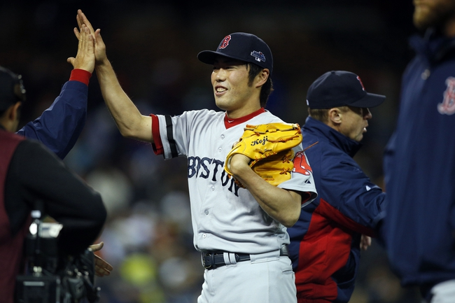 Oct 17, 2013; Detroit, MI, USA; Boston Red Sox relief pitcher Koji Uehara (19) celebrates after defeating the Detroit Tigers in game five of the American League Championship Series baseball game at Comerica Park. Boston won 4-3. Mandatory Credit: Rick Osentoski-USA TODAY Sports