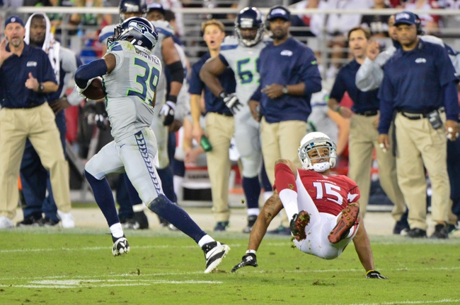 Oct 17, 2013; Phoenix, AZ, USA; Seattle Seahawks cornerback Brandon Browner (39) intercepts a pass intended for Arizona Cardinals wide receiver Michael Floyd (15) during the second half at University of Phoenix Stadium. Mandatory Credit: Matt Kartozian-USA TODAY Sports