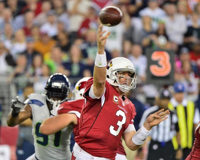 Oct 17, 2013; Phoenix, AZ, USA; Arizona Cardinals quarterback Carson Palmer (3) throws during the second half against the Seattle Seahawks at University of Phoenix Stadium. Mandatory Credit: Matt Kartozian-USA TODAY Sports