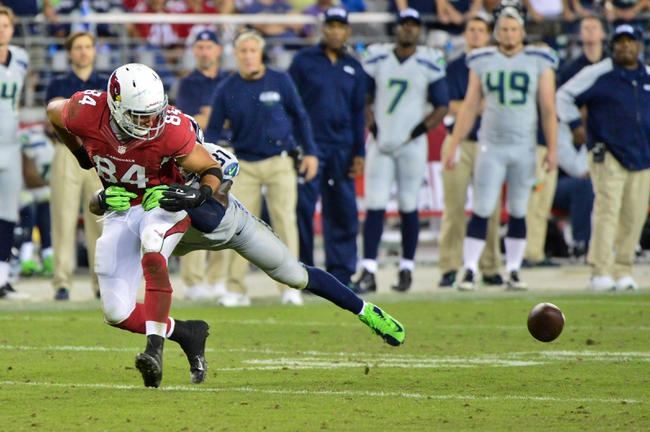 Oct 17, 2013; Phoenix, AZ, USA; Arizona Cardinals tight end Rob Housler (84) fumbles after being hit by Seattle Seahawks strong safety Kam Chancellor (31) during the second half at University of Phoenix Stadium. Mandatory Credit: Matt Kartozian-USA TODAY Sports