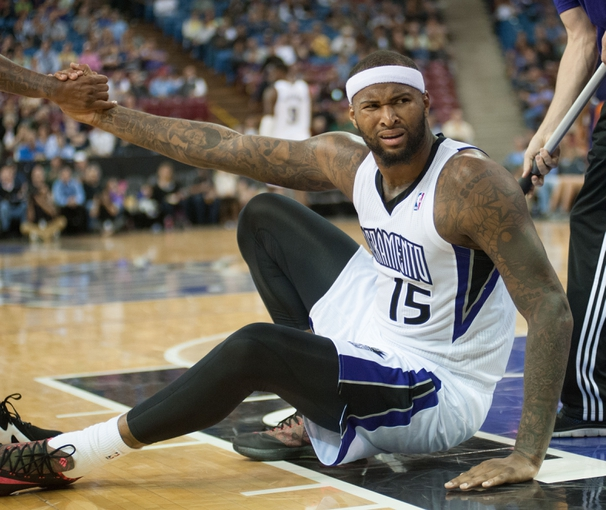 Oct 17, 2013; Sacramento, CA, USA; Sacramento Kings center DeMarcus Cousins (15) reacts to a call during the third quarter of the game against the Phoenix Suns at Sleep Train Arena. The Sacramento Kings defeated the Phoenix Suns 107-90 Mandatory Credit: Ed Szczepanski-USA TODAY Sports