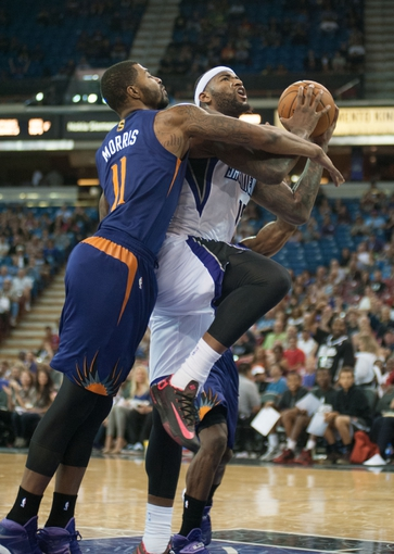 Oct 17, 2013; Sacramento, CA, USA; Sacramento Kings center DeMarcus Cousins (15) is fouled by Phoenix Suns power forward Markieff Morris (11) during the third quarter at Sleep Train Arena. The Sacramento Kings defeated the Phoenix Suns 107-90. Mandatory Credit: Ed Szczepanski-USA TODAY Sports